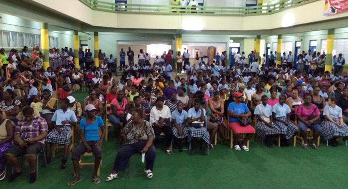 West St. George Secondary School students and their parents wait to collect laptops on Tuesday. (Photo: Camillo Gonsalves/Facebook)