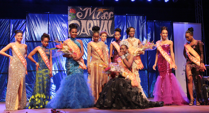 Miss Carival 2014: Miss Dominica Francine Baron, surrounded by the other contestants in the pageant, gives a thumbs-up after her crowning. (IWN Photo)